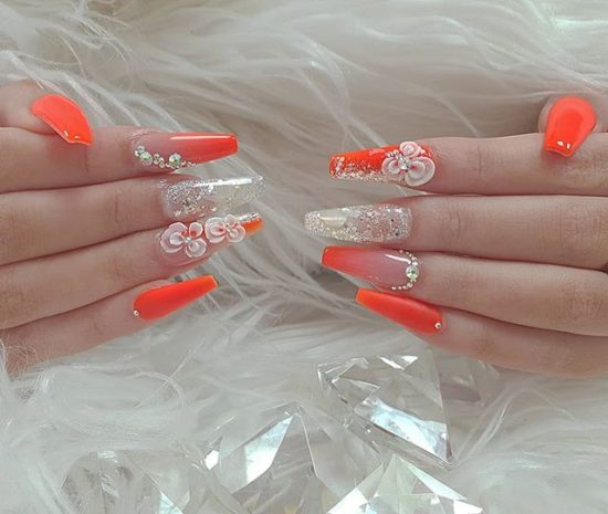Orange Color Nail Art combined with glitter and 3D Flower